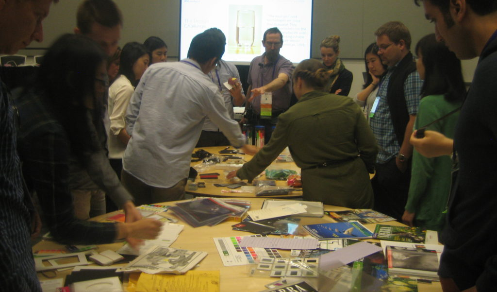 photo of participants looking at tables of materials