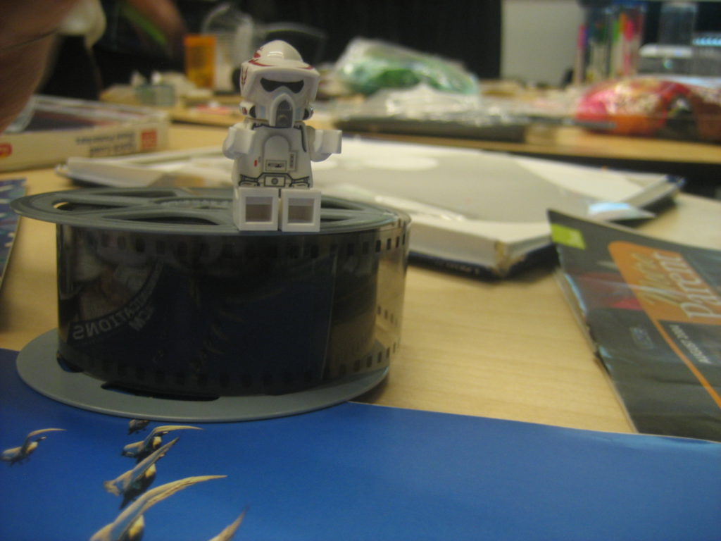 photo of toy figure on microfiche spool