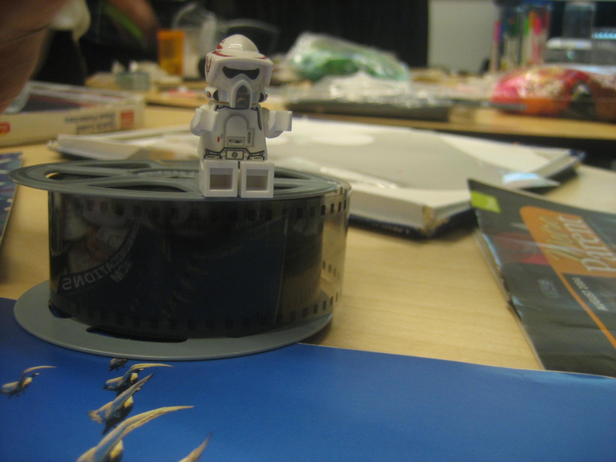 photo of toy figure on microfiche spool